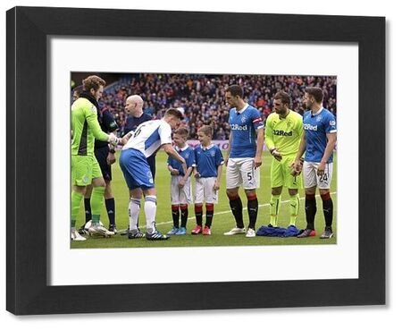 Rangers captain Lee Wallace and mascots during the second leg of the play offs at Ibrox Stadium