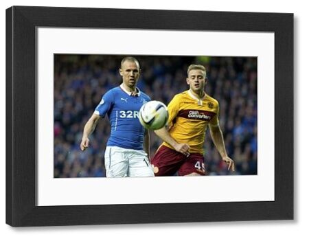 Rangers' Kenny Miller (left) and Motherwell's Louis Laing (right) during the play off final first leg at Ibrox Stadium, Glasgow