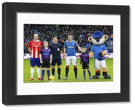 Rangers captain Lee Wallace and mascots during the William Hill Scottish Cup tie at Ibrox Stadium, Glasgow
