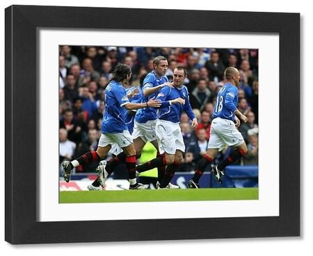 Rangers players celebrate Kris Boyd's (centre) goal