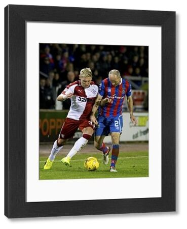 Rangers' Martyn Waghorn and Inverness' David Raven during the Ladbrokes Premiership match at the Tulloch Caledonian Stadium, Inverness