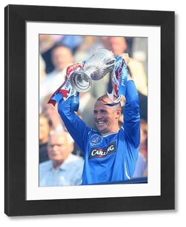 Rangers' Kenny Miller lifts the Homecoming Scottish Cup