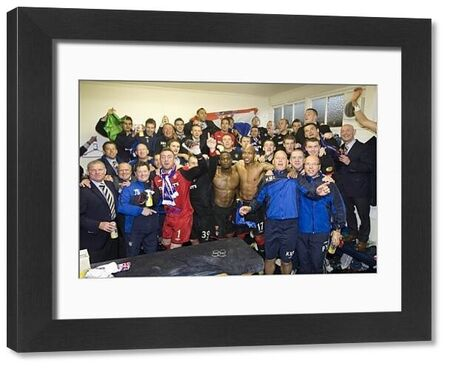EXCLUSIVE PICTURE - Rangers' players and coaching staff celebrate in the dressing room after the match