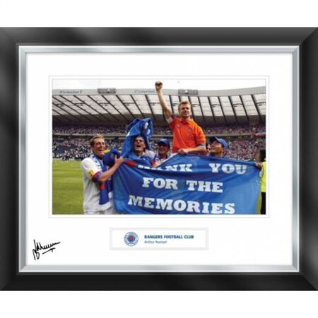 This image of Arthur Numan celebrating the cup win over Dundee in 2003, was also a fond farewell to the fans from some of the Dutch players in the side. This print has been personally signed by Arthur Numan. 588x486mm