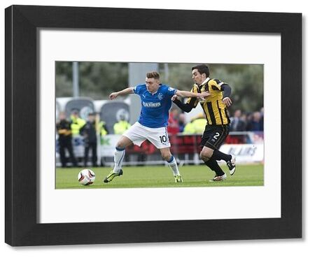 Rangers' Lewis Macleod and East Fife's Alexis Dutot during the Scottish League One match at Bayview Stadium