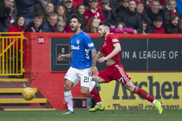 Rangers' Daniel Candeias is kicked off Aberdeen's Connor McLennan during the Scottish Cup match at Pittodrie Stadium, Aberdeen