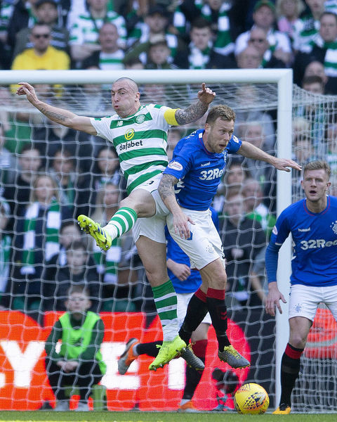 Rangers' Scott Arfield jumps with Celtic's Scott Brown during the Scottish Premiership match at Celtic Park, Glasgow