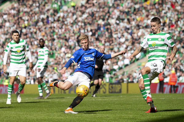Rangers' Ross McCrorie has his shot blocked by Celtic's Mikael Lustig during the Scottish Premiership match at Celtic Park, Glasgow