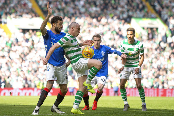 Rangers' Connor Goldson tackles Celtic's Scott Brown during the Scottish Premiership match at Celtic Park, Glasgow