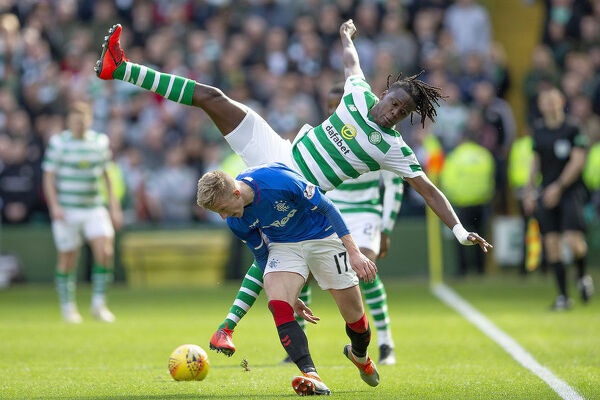 Rangers' Ross McCrorie tackles Celtic's Dedryk Boyata during the Scottish Premiership match at Celtic Park, Glasgow