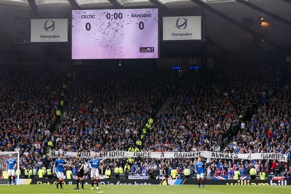 Rangers fans with a banner in memory of Ugo Ehiogu during the Scottish Cup semi final at Hampden Park, Glasgow