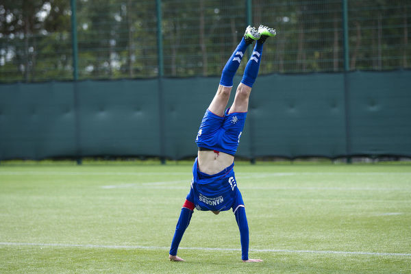 Rangers defender Kyle McClelland celebrates with a summersault after winning the league title against Hearts at the Oriam, Edinburgh