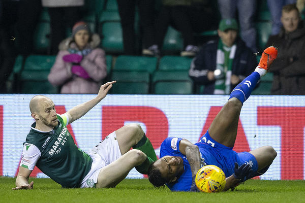 Rangers' Alfredo Morelos is fouled off Hibernian's David Gray during the Scottish Premiership match at Easter Road, Edinburgh