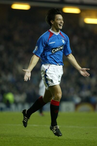 Michael Mols celebrates scoring for Rangers