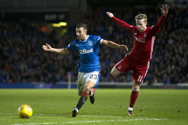 Rangers captain Jason Holt is fouled by Aberdeen's Gary MacKay-Steven during the Ladbrokes Premiership match at Ibrox, Glasgow