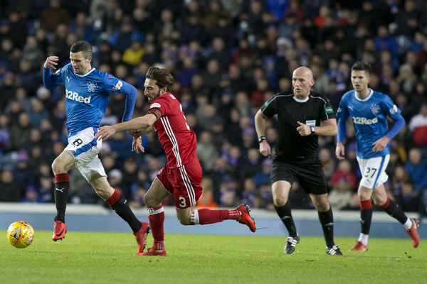 Rangers' Jamie Murphy skips past Aberdeen's Graeme Shinnie during the Ladbrokes Premiership match at Ibrox, Glasgow