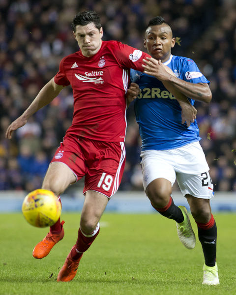 Rangers' Alfredo Morelos (right) battles with Aberdeen's Scott McKenna during the Ladbrokes Premiership match at Ibrox, Glasgow