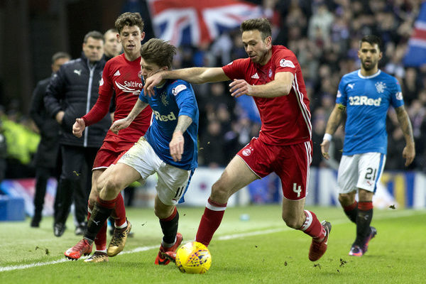 Rangers' Josh Windass and Aberdeen's Andy Considine during the Ladbrokes Premiership match at Ibrox, Glasgow