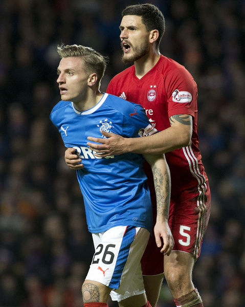 Rangers' Jason Cummings and Aberdeen's Anthony O'Connor during the Ladbrokes Premiership match at Ibrox, Glasgow