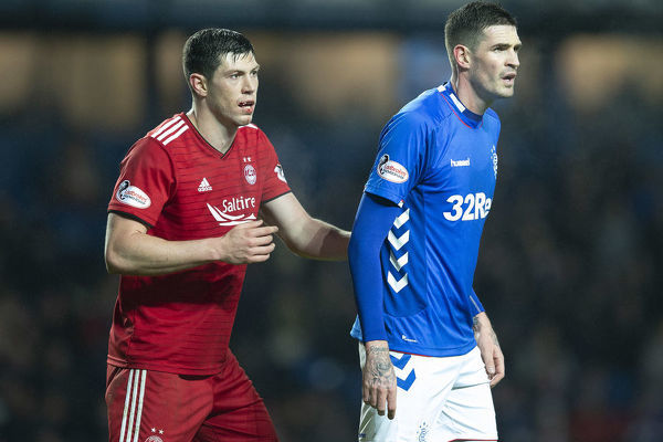 Rangers' Kyle Lafferty and Aberdeen's Scott McKenna during the Ladbrokes Premiership match at Ibrox Stadium, Glasgow