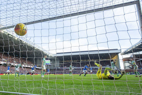 Rangers' Ryan Jack scores past Celtic goalkeeper Craig Gordon during the Scottish Premiership match at Ibrox, Glasgow