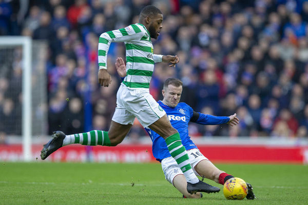Rangers' Andy Halliday puts in a strong tackle on Celtic's Olivier Ntcham during the Scottish Premiership match at Ibrox, Glasgow
