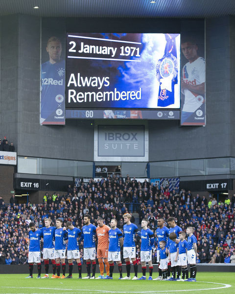 Rangers players during the minute silence in memory of the victims of the Ibrox disaster at the Scottish Premiership match at Ibrox, Glasgow