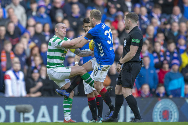 Rangers' Scott Arfield kicks Celtic's Scott Brown during the Scottish Premiership match at Ibrox, Glasgow