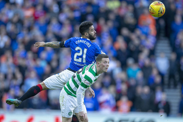 Rangers' Daniel Candeias jumps with Celtic's Callum McGregor during the Scottish Premiership match at Ibrox, Glasgow
