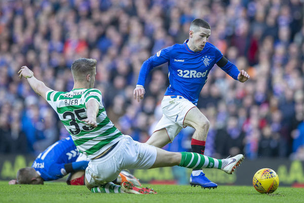 Rangers' Ryan Kent is fouled of Celtic's Kris Ajer during the Scottish Premiership match at Ibrox, Glasgow