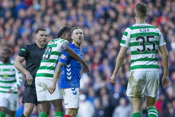 Rangers' Scott Arfield shouts at Kris Ajer and is held back by Celtic's Dedryck Boyata during the Scottish Premiership match at Ibrox, Glasgow