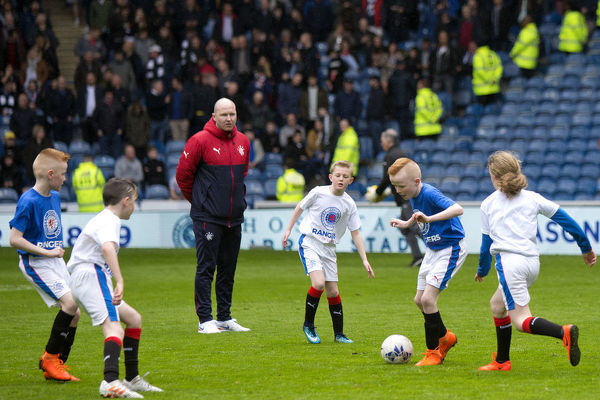 Rangers Soccer School kids entertain the fans at halt time during the Ladbrokes Premiership match at Ibrox, Glasgow