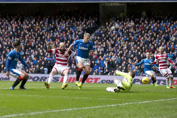Rangers' Emerson Hyndman (left) scores the first goal during the Ladbrokes Premiership match at Ibrox Stadium, Glasgow
