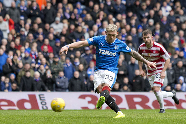 Rangers' Martyn Waghorn scores the third goal from the penalty spot during the Ladbrokes Premiership match at Ibrox Stadium, Glasgow
