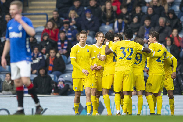 HJK Helsinki players celebrate their second goal during the friendly match at Ibrox, Glasgow