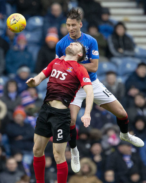 Rangers' Nikola Katic and Kilmarnock's Stephen O'Donnell jump for the ball during the Scottish Premiership match at Ibrox Stadium, Glasgow