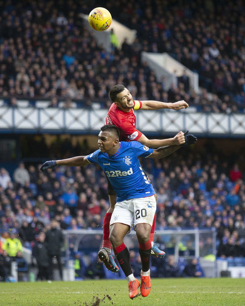 Rangers' Alfredo Morelos jumps with Kilmarnock's Gary Dicker during the Scottish Premiership match at Ibrox Stadium, Glasgow