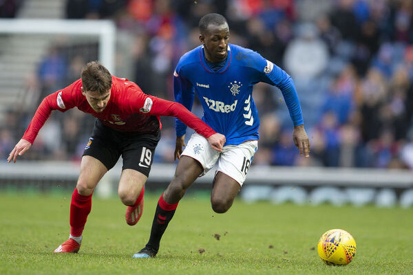 Rangers' Glen Kamara is pulled back by Kilmarnock's Liam Millar during the Scottish Premiership match at Ibrox Stadium, Glasgow