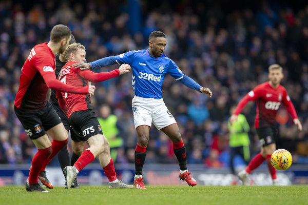 Rangers' Jermain Defoe shoves off Kilmarnock's Rory McKenzie during the Scottish Premiership match at Ibrox Stadium, Glasgow