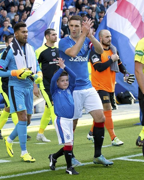 Rangers captain Lee Wallace and mascots during the Betfred Cup tie at Ibrox Stadium, Glasgow