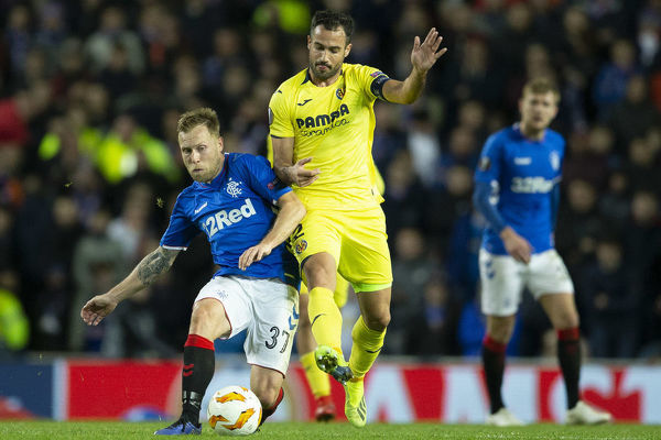 Rangers' Scott Arfield and Villarreal's Mario Gaspar during the Europa League match at Ibrox Stadium, Glasgow