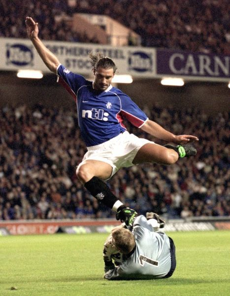Rangers' Lorenzo Amoruso run is thrwarted by Airdrieonians Allan Ferguson