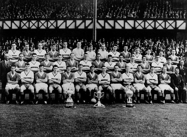 The Rangers squad show off the trophies they won in 1959-60: Scottish League Championship Trophy, The Scottish Cup, Glasgow Merchants' Charity Cup