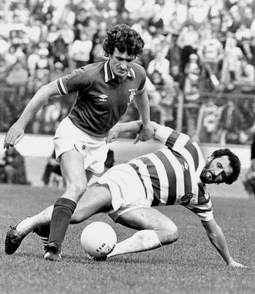 (L-R) Rangers' Sandy Jardine bursts past Celtic's Danny McGrain