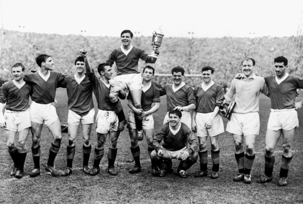The Rangers team are shown sporting the trophy which they won following their game against St Mirren From left to right: Davie Wilson, Ron McKinnon, Jim Baxter, Jimmy Millar, Eric Caldow (captain), Ralph Brand, Shearer, Willie Henderson, Ian McMillan