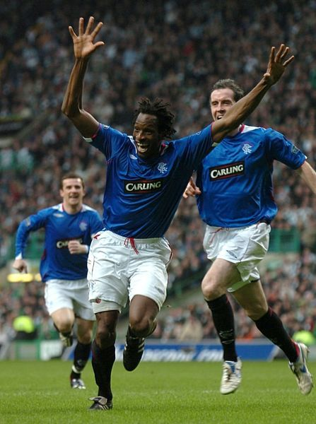 Rangers' Ugo Ehiogu (c) celebrates scoring his teams opening goal of the game