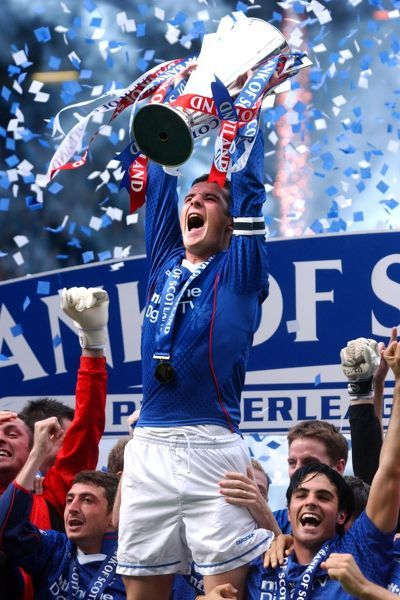 Rangers' captain Barry Ferguson holds aloft the Championship Trophy