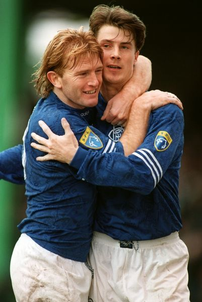 Rangers' Stuart McCall congratulates Brian Laudrup after he scored a penalty