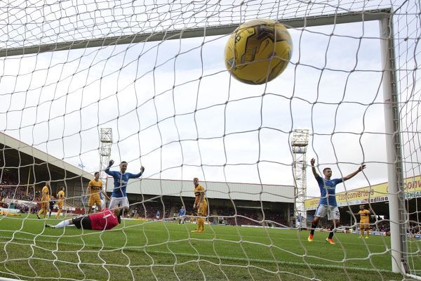 Rangers' James Tavernier scores past Motherwell goalkeeper Craig Samson during the Betfred Cup tie at Fir Park, Motherwell