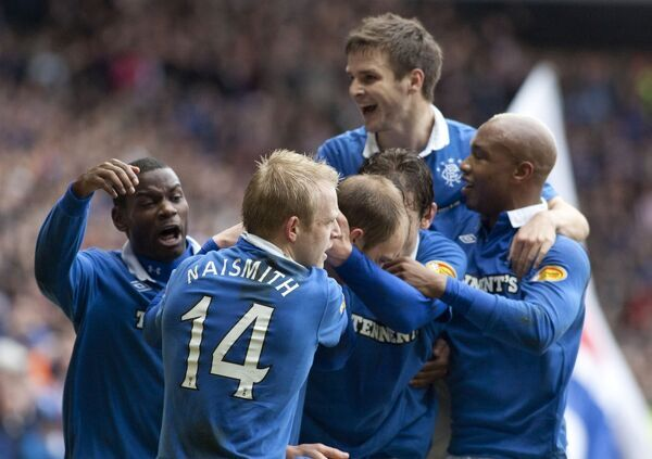Rangers' Steven Whittaker celebrates scoring with his team mates after scoring a penalty